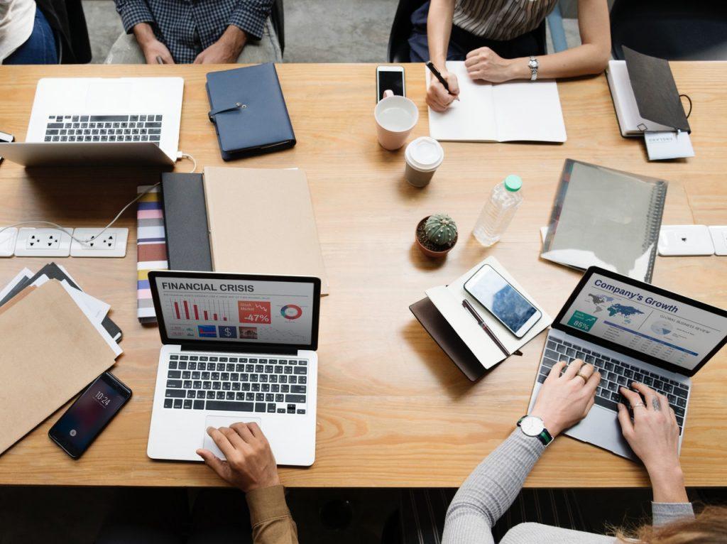 multiple computers on desk